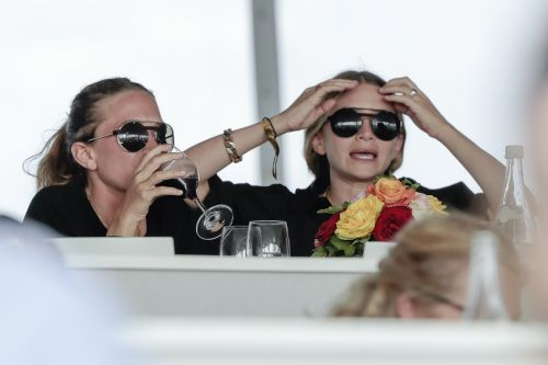 Très Chic! The Olsen Twins Spotted in France Wearing Matching Sunnies and Black Ensembles