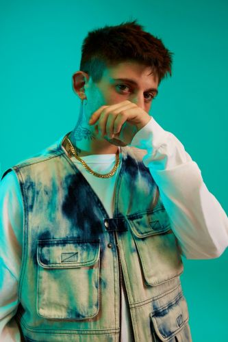 RKOMI is the Italian rapper inspired by the sounds style of Milan's youth