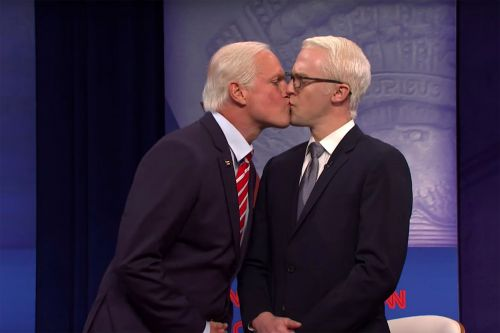 Woody Harrelson plays Joe Biden giving Anderson Cooper a kiss on 'SNL'