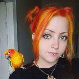 1 Woman Dyed Her Hair to Match Her Parrot, Because That's What Friends Do I Guess