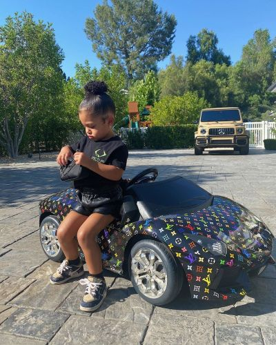 Kylie Jenner's Daughter Stormi Webster Owns a Rainbow Louis Vuitton Toy Car. Yep, You Read That Right