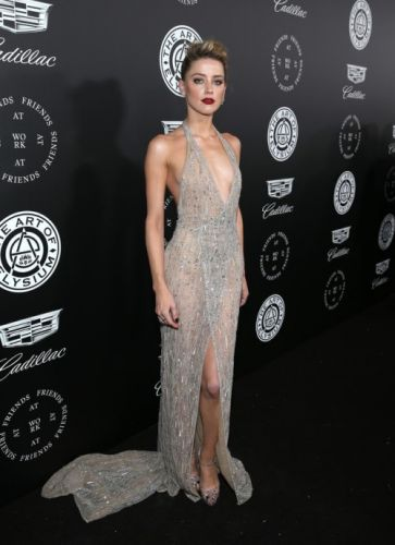 Amber Heard wears a silver tulle wrap dress, fully embroidered