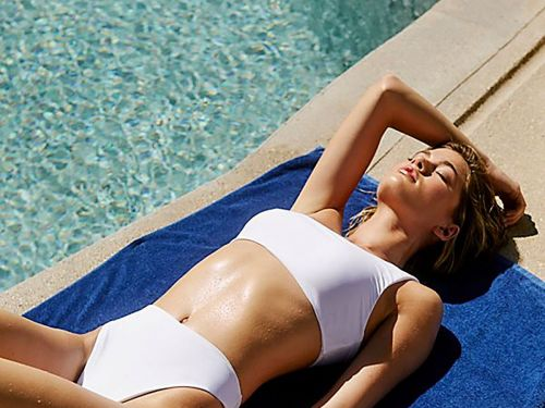 Stand Out At The Pool Party With One Of These White Swimsuits