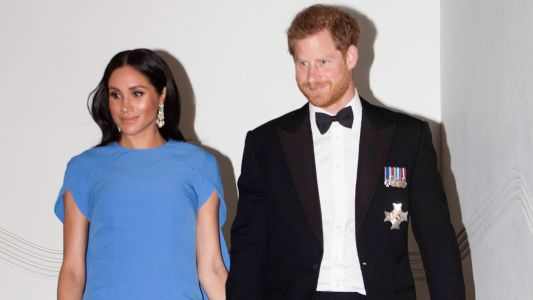Meghan Markle Cradles Her Baby Bump In Sweet New Pics!