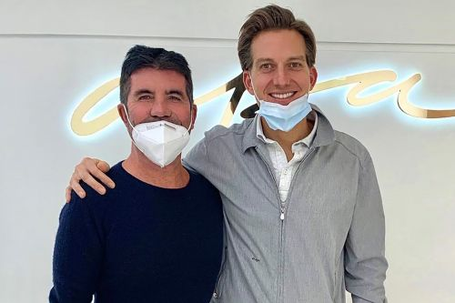 Simon Cowell back on his feet after bike crash, gets new veneers