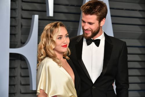 Miley Cyrus Is Showing Pregnancy Signs and Liam Hemsworth Is Loving It, Sources Say