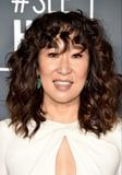 Sandra Oh Is the Only Person We Know Who Can Pull Off Tightly Curled Bangs