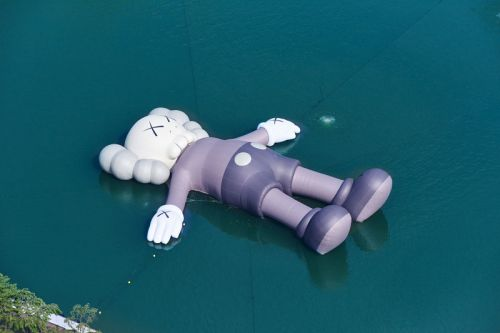 Catch The Extra Large-Scale 'KAWS:HOLIDAY' Sculpture Set Sail in Seoul's Seokchon Lake