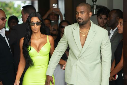 Kanye rolls into wedding looking like mental hospital escapee