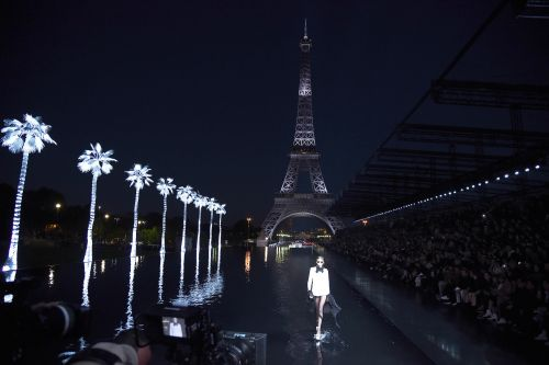 Models walk on water at Paris Fashion Week show