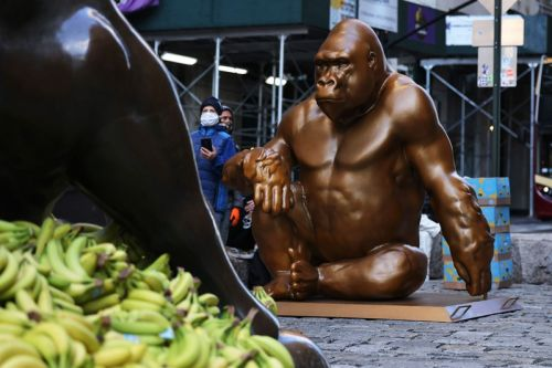 A Seven-Foot Tall Harambe Statue Has Appeared Opposite Wall Street's Charging Bull Covered in Bananas