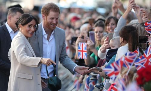 Prince Harry Hilariously High-Fives Kids Who Reportedly Skipped School To See Him And Meghan Markle