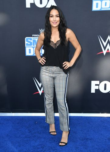 Twirl! Brie Bella Cradles Baby Bump in Short, Fringe Dress and Knee-High Boots: 'Rockin' Mama'
