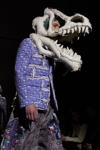 Rebel boys in dinosaur masks at Comme des Garçons